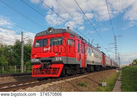 Moscow 02/06/2019 Red Branded Rzd (russian Railways) Intercity Electric Train Approaching Against Bl