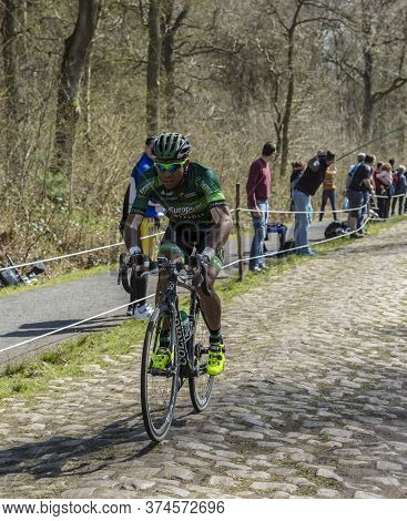 Wallers,france - April 12,2015: The French Cyclist, Yohann Gene Of Europcar Team Riding On A Cobbles