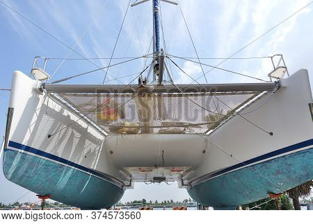 A Large Catamaran Yacht With A Double Hull Seen From Below