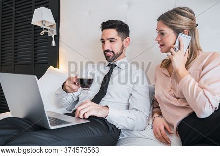 Two Business People Working Together On Laptop.