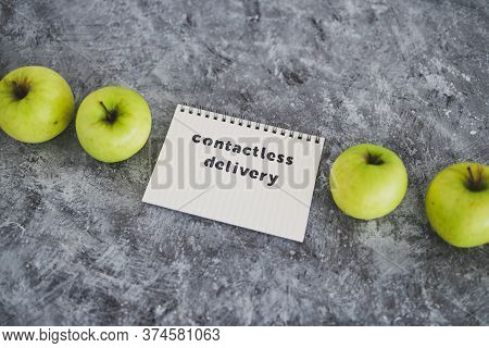 Contactless Delivery Text On Notepad Among Apples Concept Of Groceries Shopping During Quarantine Or