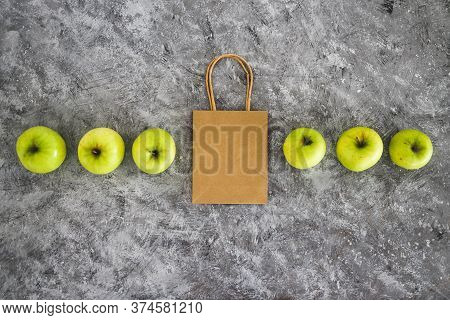 Home Delivery And Groceries Shopping Concept, Shopping Bag Among Apples Symbol Of Healthy Nutrition