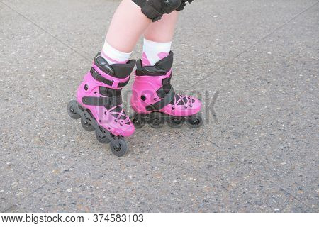 Teenager Girl In Roller Skates. Pink Roller Skates. Active Young Girl. Outdoors Sport Activity. Unre