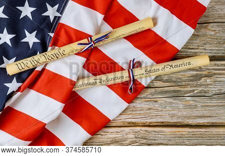 American Holiday. Declaration Of Independence Parchment Roll Document With Us Flag On White Backgrou