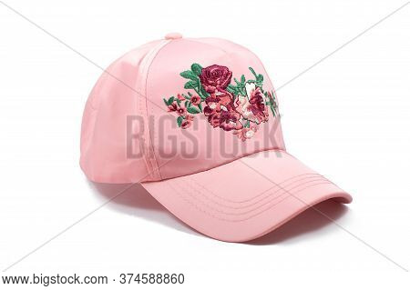 Casual woman cap with flowery details. Isolated trendy cap on a white background. Isolated. Close up