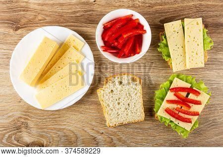 Slices Of Cheese In White Plate, Bowl With Slices Of Sweet Pepper, Slice Of Wheat Bread, Sandwiches