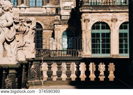 Dresden, Tourists In Zwinger. Dresden.dresden Historical Palace, And A Tourist Attraction In The Cit