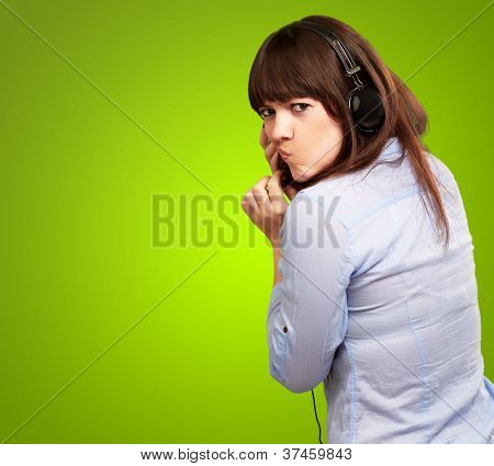 Woman With Headphones And Pouted Lips Isolated On Green Background