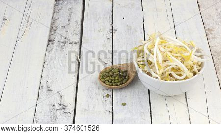 Bowl Of Raw Mung Bean Sprouts And Spoon Of Mung Beans