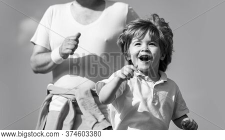 Child Running In Stadium. Kid Run On Outdoor. Healthy Family Concept. Father And Son Play Sports And