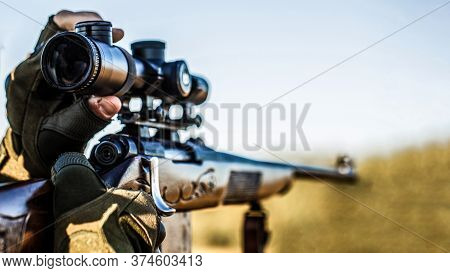 Hunt Hunting Rifle. Hunter Man. Hunting Period. Male With A Gun. Close Up. Hunter With Hunting Gun A