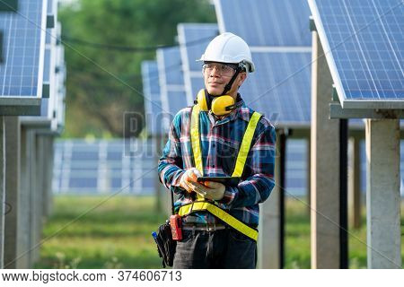 Electrician Checking Solar Panels,green Energy,solar Power Plant To Innovation Of Green Energy For L