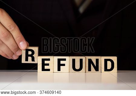 Wooden Blocks With The Text: Refund, Concept