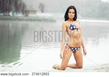 Beautiful Sensual Young Woman In A Swimsuit On The Beach