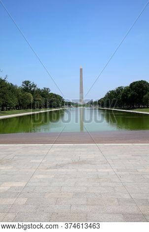 Washington Dc, Usa - May 02, 2019: Washington Column And Tourists With Lincoln Memorial Reflecting P
