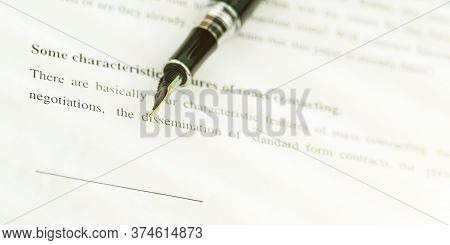 Designed Fountain Pen Of Black Colour Lies On Sheet Of Paper Document Under Bright Electric Light Ex