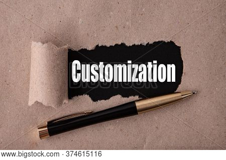 Customization Text Written Under Torn Paper And A Recumbent Metal Pen. Business Strategy Concepts.