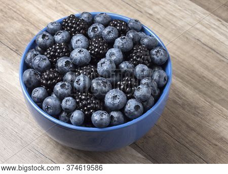 Forest Berries (blueberry,bramble) In A Ceramic Blue  Bowl.