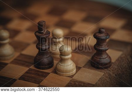 Chess Board And Chess Pieces, Wooden Chess Pieces On A Chess Board. Close-up, Pawn And Queen, Dark A