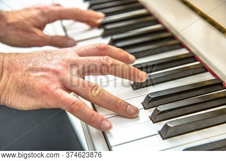 Man Hands Playing Piano. Close-up With Shallow Dof. Fingers On Digital Piano Keys Playing Music.