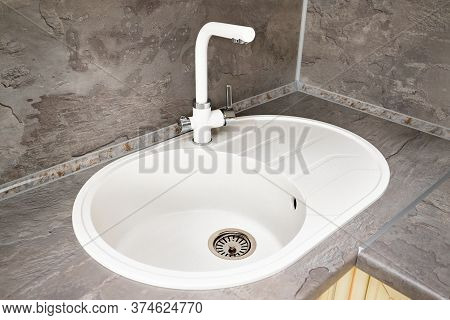 Kitchen Luxurious Interior With Stone Sink And Faucet Double Tap Mixer In Modern Contemporary Design