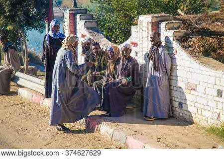 Luxor,Egypt - Jan 28, 2020: A group of old  Egyptians dressed in traditional costumes.  Egypt.