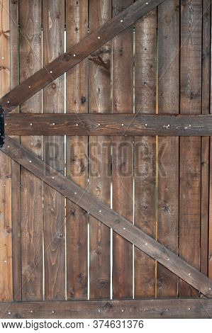 Old Wooden Door, Closeup. Traditional Wooden Door. Old Rustic Wooden Surface With Planks. Old Wooden
