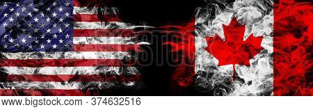 American Flag And Canadian Flag In Smoke Shape On Black Background.business Concept Of World Conflic