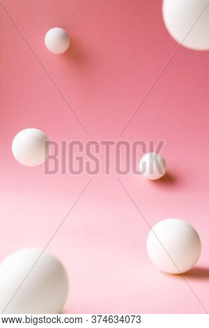 Levitation White Abstract Spheres On Pink Background With Selective Focus, Front View. Backdrop Temp
