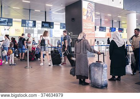 Airport Platov, Russia - 24.05.19: Queue For Tickets At The Airport Terminal. Old Ladies Are Traveli