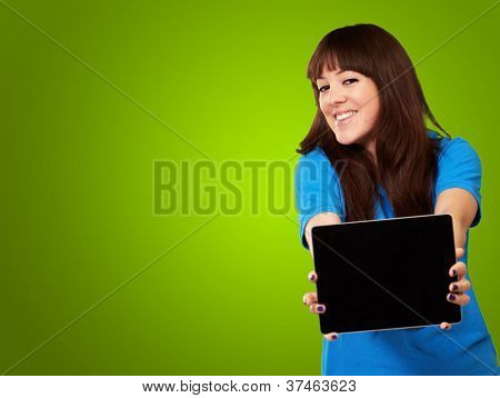 Woman Holding Ipad Isolated On Green Background