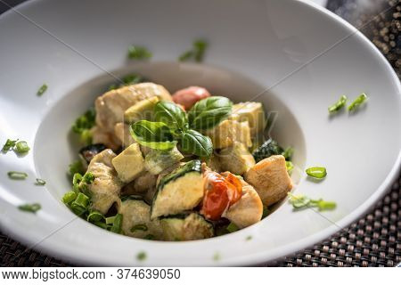 Cooked Chicken Pieces With Cooked Vegetables