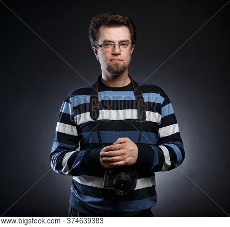 Image Of Bearded Photographer With Slr Camera