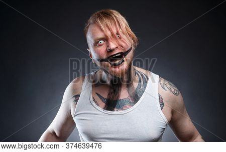 Tattooed Scary Mad Man With Horror Make-up