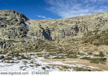 Rascafria - December 28, 2016: Hikers In The Hiking Route To The Laguna Grande De Penalara (penalara