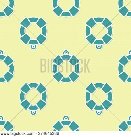 Green Lifebuoy Icon Isolated Seamless Pattern On Yellow Background. Lifebelt Symbol. Vector