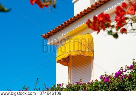 White House With Red Flowers Against Bright Blue Sky, Puerto De La Cruz, Tenerife, Spain