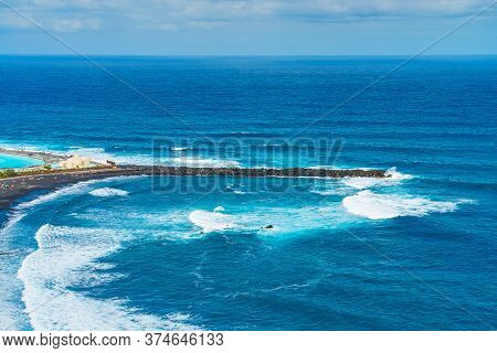 Breakwater Of Beach With Black Sand. Playa De Martianez, Puerto De La Cruz, Tenerife, Spain
