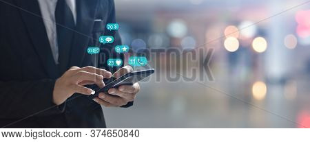 Businessman Using Smartphone With Social Network Icon , Copy Space. Idea For Business, Online Bankin