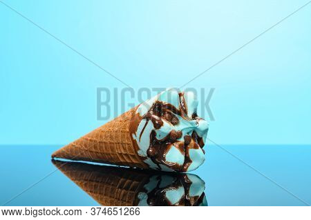 Fresh Salted Caramel Flavor Ice Cream Cone On A Glass With Reflection