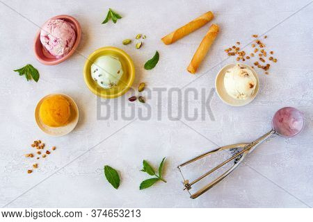 Set Of Soft Ice Cream Scoops Or Frozen Yogurt, Sorbet Of Different Flavours . Top View