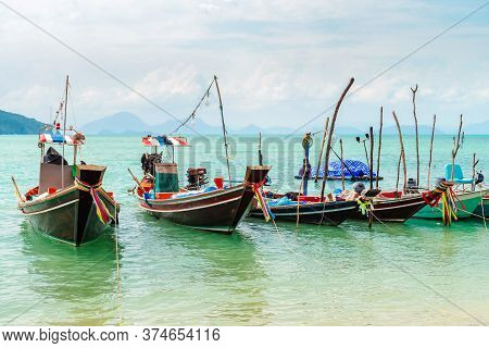 Authentic Thai Long Tail Fishing Boats Docked At Thong Krut Beach On A Day, Koh Samui, Thailand