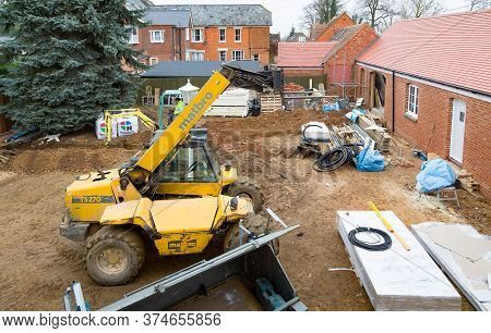 Buckingham, Uk - December 02, 2016. Building Work, Construction Site With Heavy Machinery On A Herit