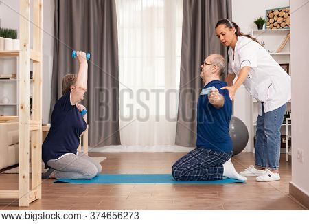 Therapist Helping Old People To Recover After A Medical Intervention. Home Assistance, Physiotherapy
