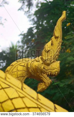 Gilded Naga Serpent, A Mythological Protector Creature, At The Entrance Of A Buddhist Temple In Luan