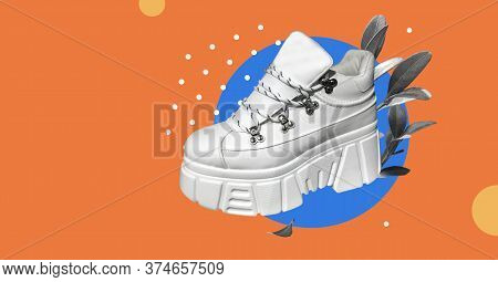 White High-top Sneakers With Fresh Plants Isolated On Abstract Colorful Background. Mountain-style P