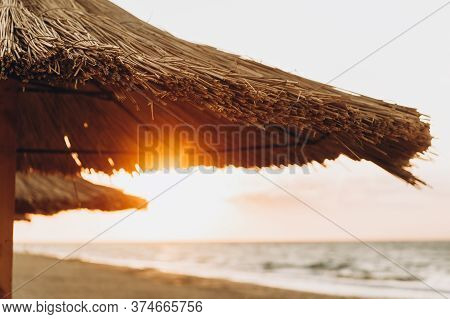 Thatched Hut, Bungalows On The Beach At Dawn, Summer Holiday On The Ocean Coast