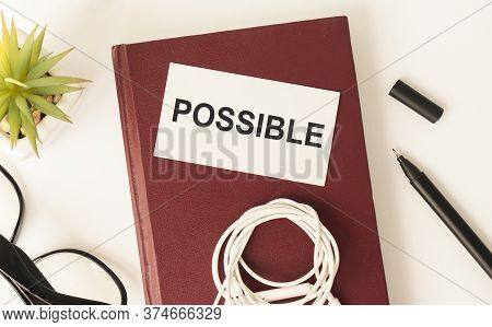 Notepad With Text Possible On A Yellow Background, Near Glasses And Office Supplies.