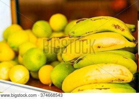 Fruits On A Shop Counter In Puerto De La Cruz. Bananas And Lemons.