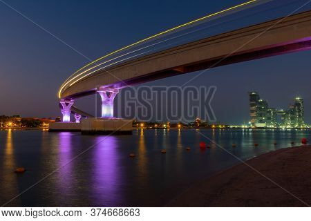 Night View Of The Bridge Next To Luxurious Atlantis Hotel In Palm Jumeirah Taken At The Blue Hour. T